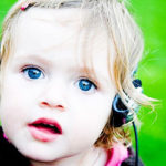 Image of little girl with headphones